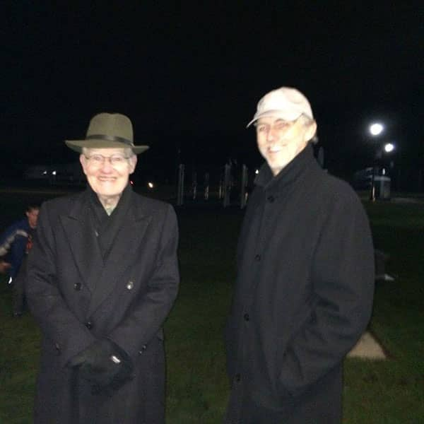 Two People in Black Coats